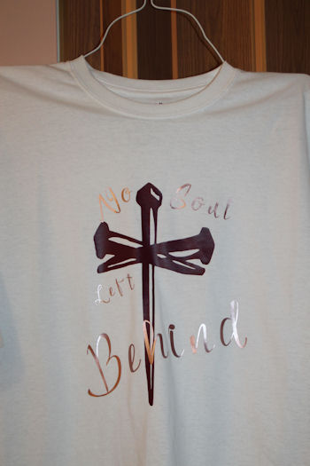 #5083 No Soul Left Behind T Shirt White T Shirt with the cross maroon in the middle, writing cursive letters in mauve color